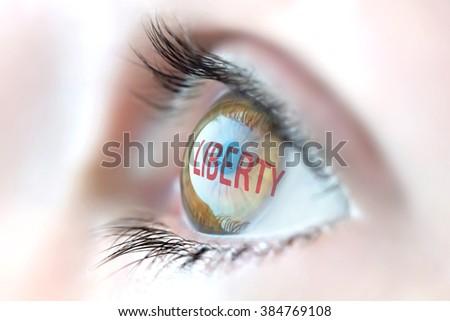Liberty reflection in eye. - stock photo
