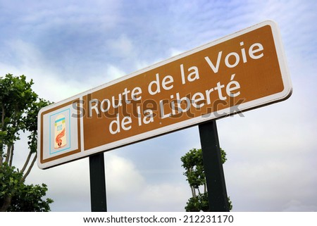 Liberty Road sign - Path of Liberty is the commemorative way marking the victorious route of the Allied forces from D-Day in June 1944. Starts in Ste.-M�¨re-��glise, France and ends in Bastogne, Belgium - stock photo