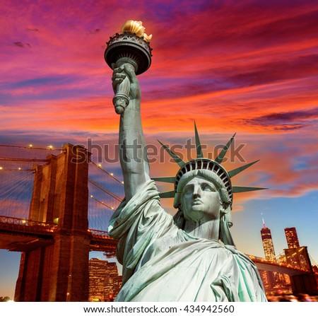 Liberty Statue and Brooklyn bridge New York American Symbols USA photomount - stock photo