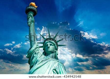 Liberty Statue New York American Symbol USA on dramatic sky photomount - stock photo