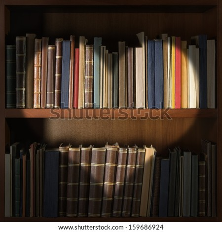 Library bookshelf with heart shape light - stock photo