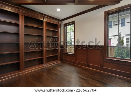 Library in new construction home with ceiling beam - stock photo