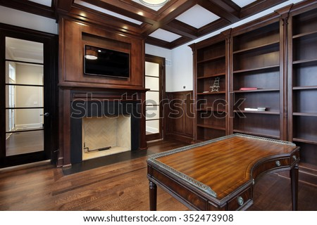 Library in new construction home with fireplace - stock photo