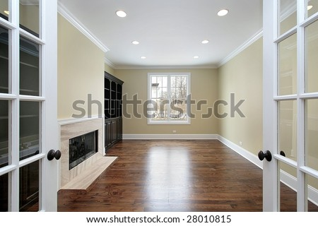 Library in new construction home with french doors - stock photo