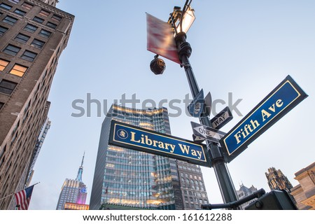Library Way street sign with skyscrapers at sunset - New York City. - stock photo