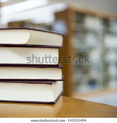 library with stack of books. - stock photo