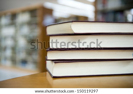 library with stack of books.