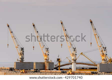 LIBREVILLE, GABON - MAR 6, 2013: Crane in the Port of Libreville, Gabon. Port of Libreville is a trade center for a timber region.
