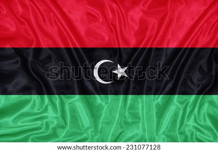 Libya flag pattern on the fabric texture ,vintage style - stock photo