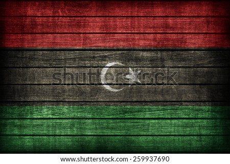 Libya flag pattern on wooden board texture ,retro vintage style - stock photo