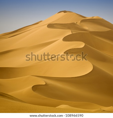Libyan Sahara. Dunes. Sand structure at sunset. - stock photo