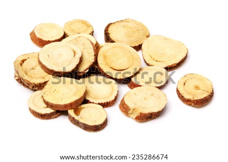 Licorice roots on white background - stock photo