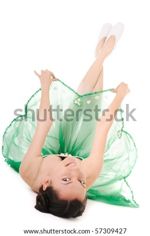 Lie young woman in green ballet dress on white background - stock photo