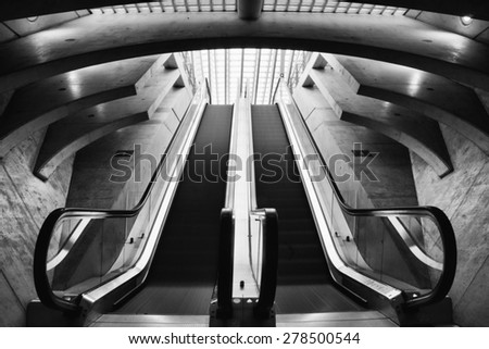 LIEGE, BELGIUM  - 5 OCTOBER 2014: Escalator in the Liege-Guillemins railway station, designed by Santiago Calatrava.  Photo taken on October 5 2014 in Liege, Belgium.