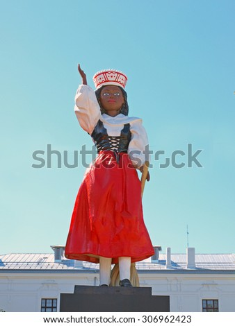 LIEPAJA, LATVIA - AUGUST 16, 2015: The statue of black woman in latvian national costume is installed on Graudu street as symbol of people migration result.