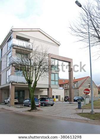 LIEPAJA, LATVIA - FEBRUARY 22, 2016: Entrance in house yard is blocked with lifting electric barrier. - stock photo