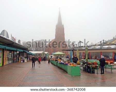 LIEPAJA, LATVIA - JANUARY 27, 2016: Fruit and vegetable sellers are working on central market in foggy day.    - stock photo