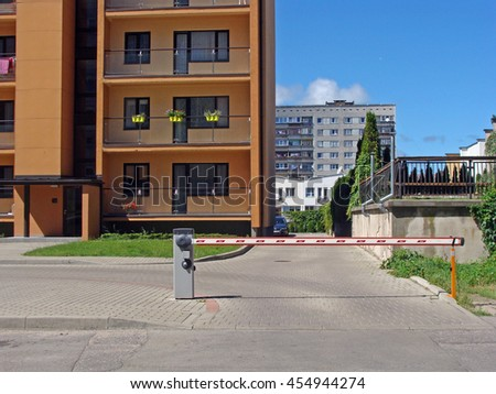 LIEPAJA, LATVIA - JULY 19, 2016: On Daugava street newly built apartment houses have separate individual parking places with electronic lifting barrier. - stock photo