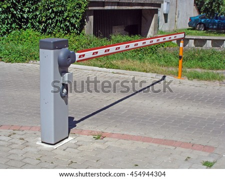 LIEPAJA, LATVIA - JULY 19, 2016: On Daugava street newly built apartment houses have separate individual parking places with electronic lifting barrier and radio trigger. - stock photo