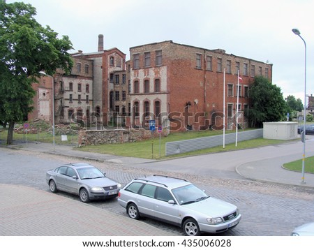 LIEPAJA, LATVIA - JUNE 10, 2016: Abandoned leather factory red brick buildings ruins are located on Barinu street.                                - stock photo