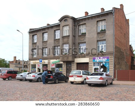 LIEPAJA, LATVIA - JUNE 2, 2015: The facade of old historical house is restored in retro architectural style.     - stock photo