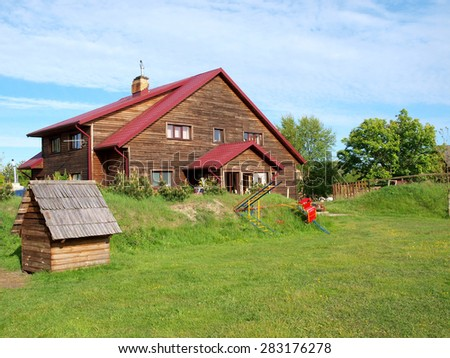 LIEPAJA, LATVIA - MAY 28, 2015: Guest house is built for tourists near town border and forest. - stock photo