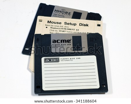 LIEPAJA, LATVIA - NOVEMBER 19, 2015: Floppy disks made in different companies are used for data storage on older computers. - stock photo