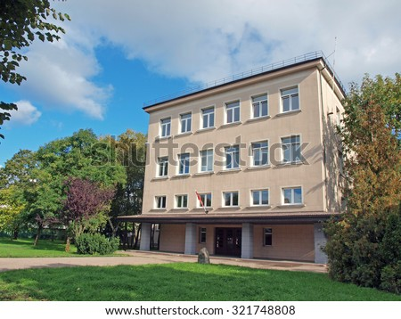 LIEPAJA, LATVIA - SEPTEMBER 28, 2015: Liepaja fifth high school is located on Rigas street before bus station.         - stock photo
