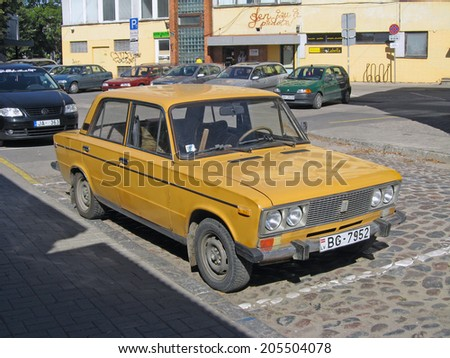 LIEPAJA, LATVIA - SEPTEMBER 8, 2013: Retro russian car VAZ-2106 Lada is standing on parking place. - stock photo