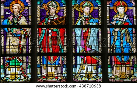 LIER, BELGIUM - MAY 16, 2015: Stained Glass in St Gummarus Church in Lier, depicting the Orthodox Church Fathers Saints Gregory of Nazianzus, Athanasius of Alexandria, John Chrysostomus and Basil - stock photo