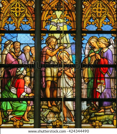 LIER, BELGIUM - MAY 16, 2015: Stained Glass window (1860) in St Gummarus Church in Lier, Belgium, depicting the Baptism of Jesus by Saint John in the River Jordan