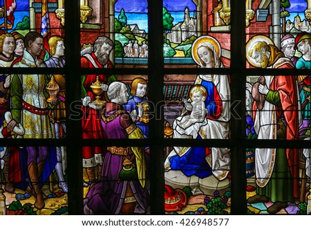 LIER, BELGIUM - MAY 16, 2015: Stained Glass window in St Gummarus Church in Lier, Belgium, depicting the Visit of the Three Kings or Three Wise Men