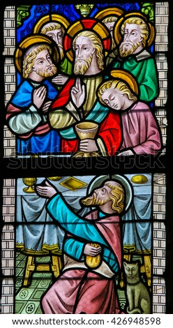 LIER, BELGIUM - MAY 16, 2015: Stained Glass window in St Gummarus Church in Lier, Belgium, depicting Jesus and the Apostles at the Last Supper, with the traitor Judas Iscariot in front. - stock photo