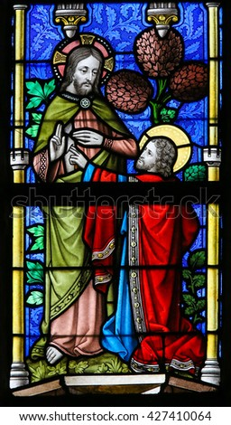LIER, BELGIUM - MAY 16, 2015: Stained Glass window in St Gummarus Church in Lier, Belgium, depicting Saint Thomas touching Jesus' wound - stock photo