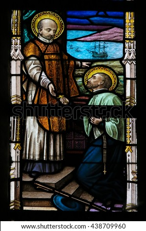 LIER, BELGIUM - MAY 16, 2015: Stained Glass window in St Gummarus Church in Lier, Belgium, depicting Saints Francis Xavier and Ignatius of Loyola, the founders of the Jesuit order. - stock photo