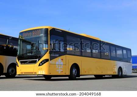 LIETO, FINLAND - APRIL 5, 2014: Yellow Volvo 8900 city bus parked on a yard. The 8900 has a Volvo D8K Euro 6 engine, which is one of the world's most fuel-efficient bus diesel engines. - stock photo