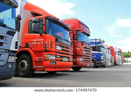 LIETO, FINLAND - AUGUST 3, 2013: Row of used Scania trucks. Ecolution by Scania aims to offer customers cost-effective and environmentally sustainable transport solutions. - stock photo