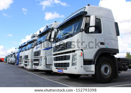LIETO, FINLAND - AUGUST 31: Row of Volvo trucks on August 31, 2013 in Lieto, Finland. With its companies Volvo Trucks and Renault Trucks, the Volvo Group has over 1 million trucks operating in Europe. - stock photo