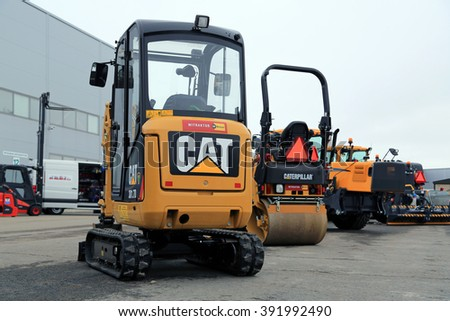 LIETO, FINLAND - MARCH 12, 2016: Cat 301.7D Mini hydraulic excavator and other Cat construction equipment as seen at the public event of Konekaupan Villi Lansi Machinery Sales.  - stock photo