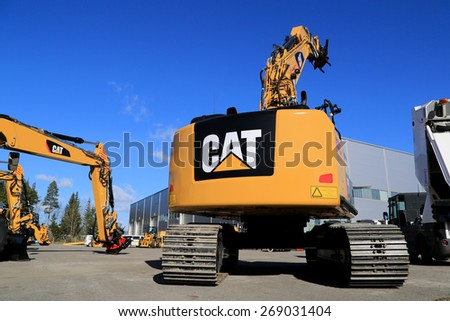 LIETO, FINLAND - MARCH 21, 2015: Cat 320E hydraulic excavator on a yard. The Cat 300 series excavators were first introduced in the 1990s.  - stock photo