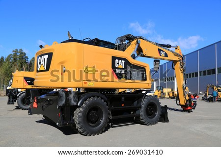LIETO, FINLAND - MARCH 21, 2015: Cat M318F Wheel Excavator on a yard. The M318F has standard rear and side wide angle cameras for operator to see what is going on around. - stock photo