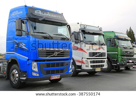 LIETO, FINLAND - NOVEMBER 14, 2015: Lineup of three used Volvo trucks as seen on the Volvo Truck Center Turku Demo Drive and Tire Service Event. - stock photo