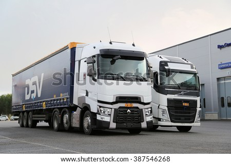 LIETO, FINLAND - NOVEMBER 14, 2015:  Renault Trucks T and Volvo FH 500 semi are available for test drive at the Volvo Truck Center Turku Demo Drive and Tire Service Event. - stock photo
