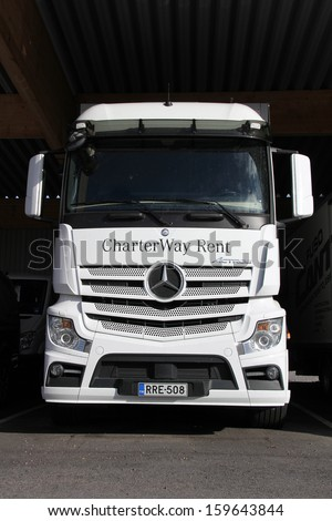 LIETO, FINLAND - October 12: Mercedes-Benz Actros truck on October 12, 2013 in Lieto, Finland. MB Actros is worlds most successful heavy-duty truck with ca. 800,000 sales since its launch in 1996.  - stock photo