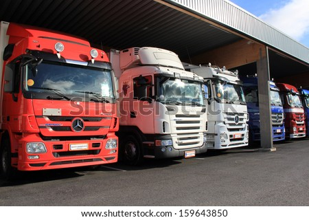 LIETO, FINLAND - October 12: Mercedes-Benz and Scania trucks on October 12, 2013 in Lieto, Finland. Finland seeks logistic efficacy by raising the max permissible masses and dimensions of trucks. - stock photo