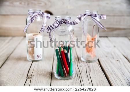 Life accumulation of money, hobbies, school, life. concept - stock photo