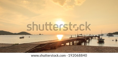 Life at wooden bridge on the way to the harbor in Sunset time at Ko Mak island, thailand - stock photo