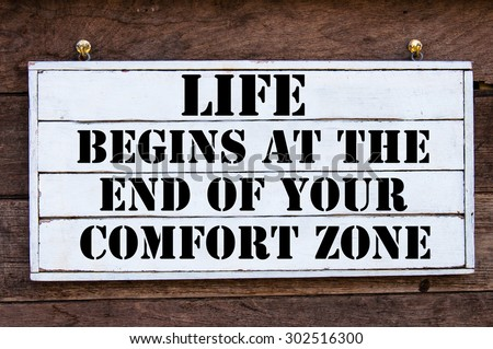 Life Begins At The End Of Your Comfort Zone Inspirational message written on vintage wooden board. Motivation concept image - stock photo