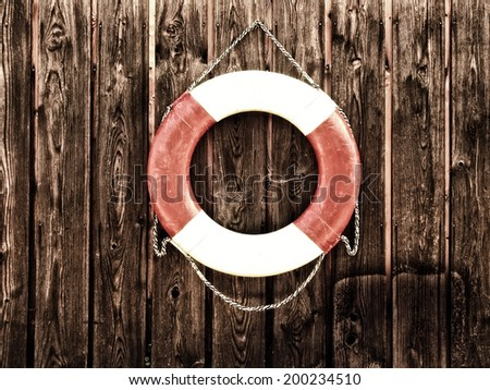 life belt (42 on wooden wall - stock photo