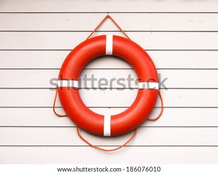 life belt, rescue ring (36) on wooden wall - stock photo